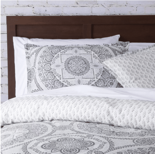 bed sheet or cove color grayish with white color in abstract design including the pillow, bed cover, and blanket