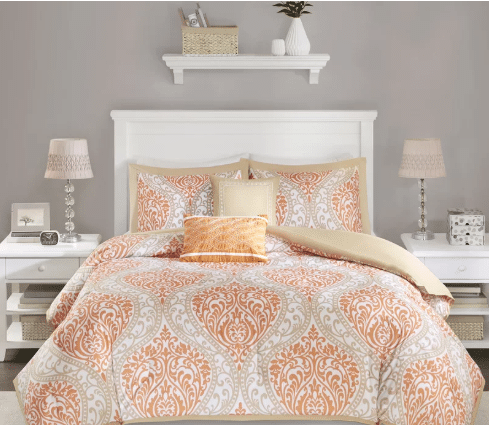 a peach or pink color and white combination of bed sheets, pillows and blanket interior