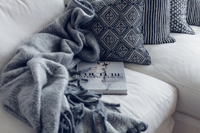 couture-book-on-sofa best blankets-comfort-comfortable-1421176