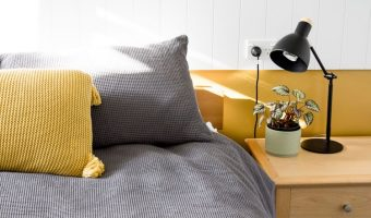 yellow and gray knit pillows inside bedroom