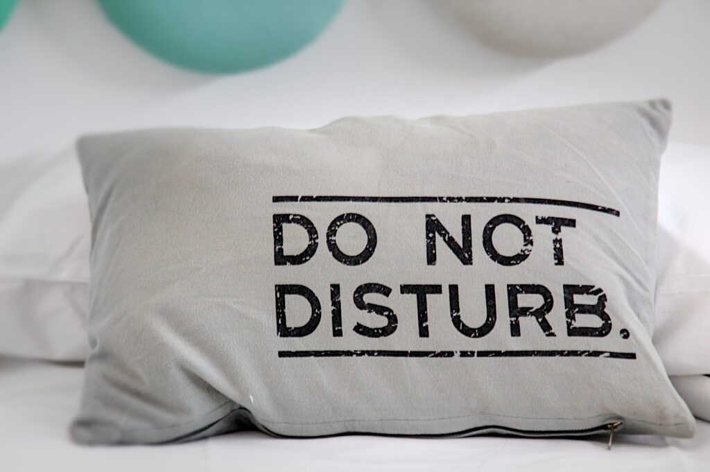A pillow that says Do Not Disturb