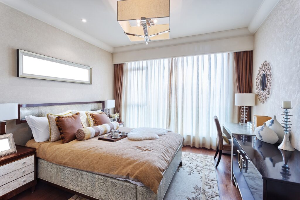 A bedroom decorated in tan, white, and cream colors
